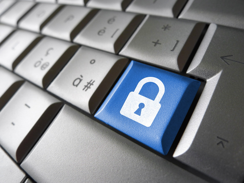 Internet, web and computer data security concept with padlock icon and symbol on a blue laptop key for website and online business.
