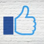 Facebook thumbs up on wall